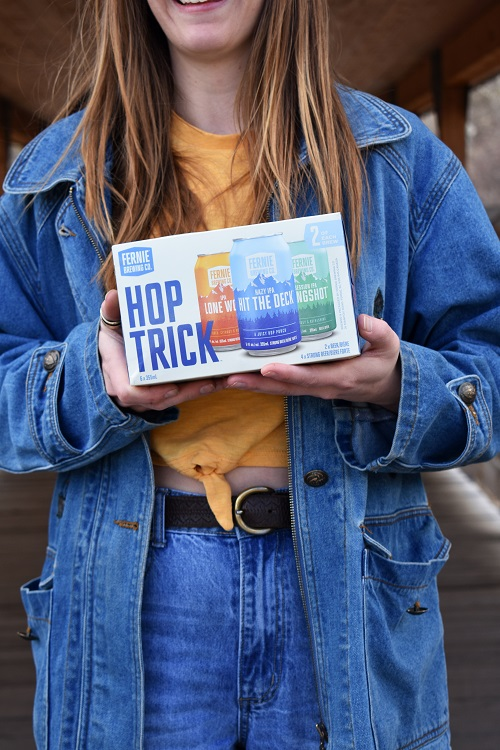 Gal holding a pack of hop trick