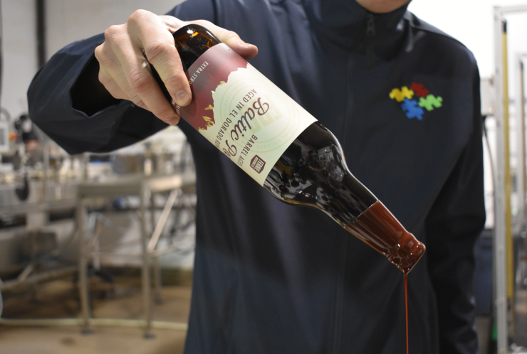 Barrel Aged Baltic Porter being dipped in wax