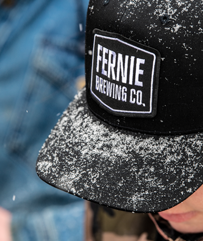 Fernie brewing Co. trucker hat with snow on it