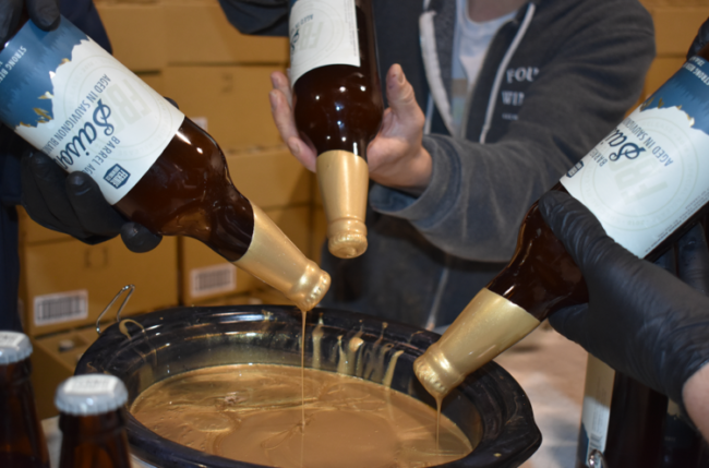 Barrel Aged Saison being wax dipped
