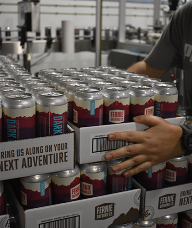 Cans being stack at a brewery