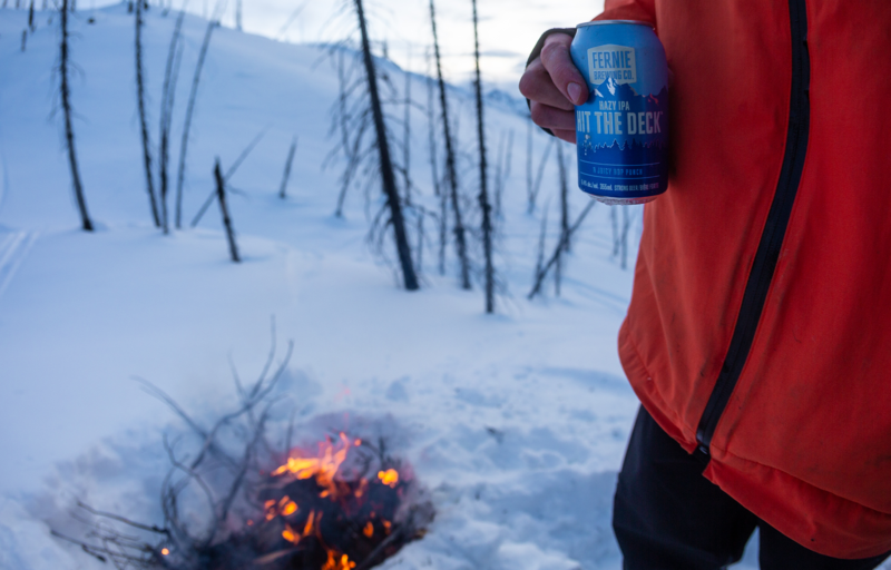 Hit the Deck Hazy IPA in the snow by a fire