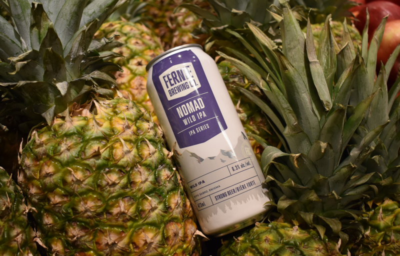 Nomad Wild IPA next to pineapples