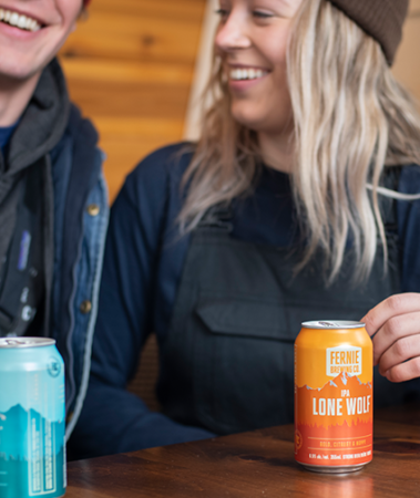 Woman and man drinking a Lone Wolf IPA