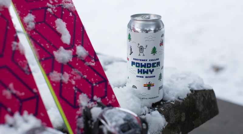 Powder Hwy Dark Saison next to skis