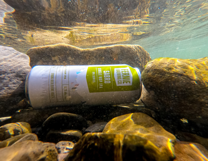 A can of Sabro Single Hop IPA in a river