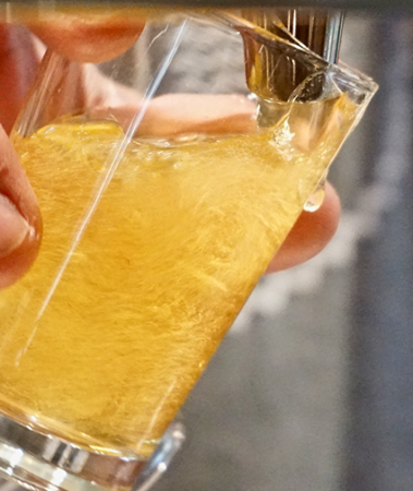 Sample of beer being pourted