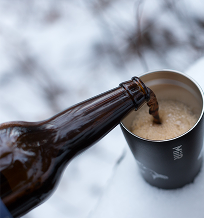 Black Mammoth Winter Ale being poured into a MiiR tumbler