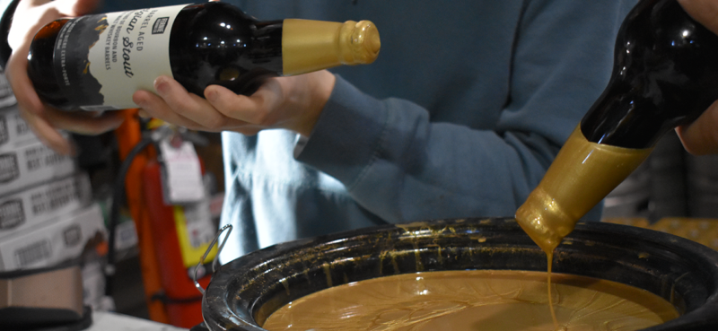Barrel Aged Belgian Stout being wax dipped