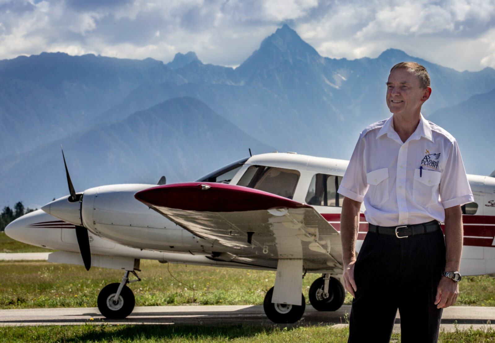 Brent Bidston of Angel Flight East Kootenay stands in front of his plane.