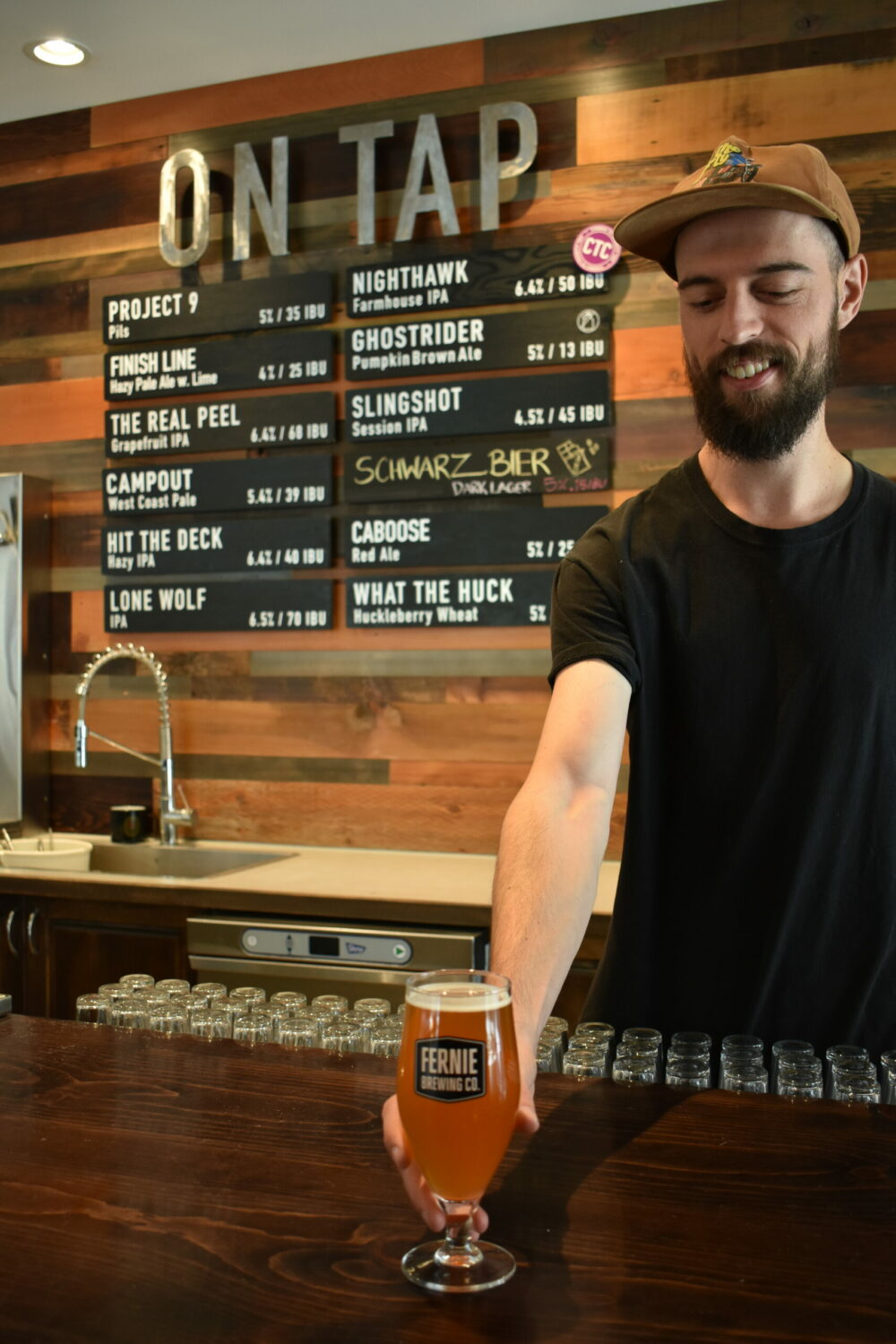 Man serving a beer at the Fernie Brewing Co. Tasting Room.