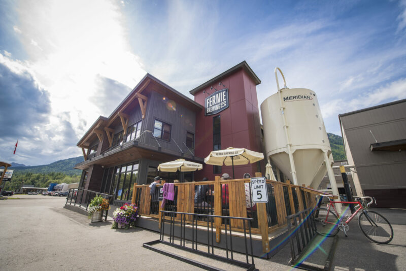 The outside of Fernie Brewing Co. during summer.