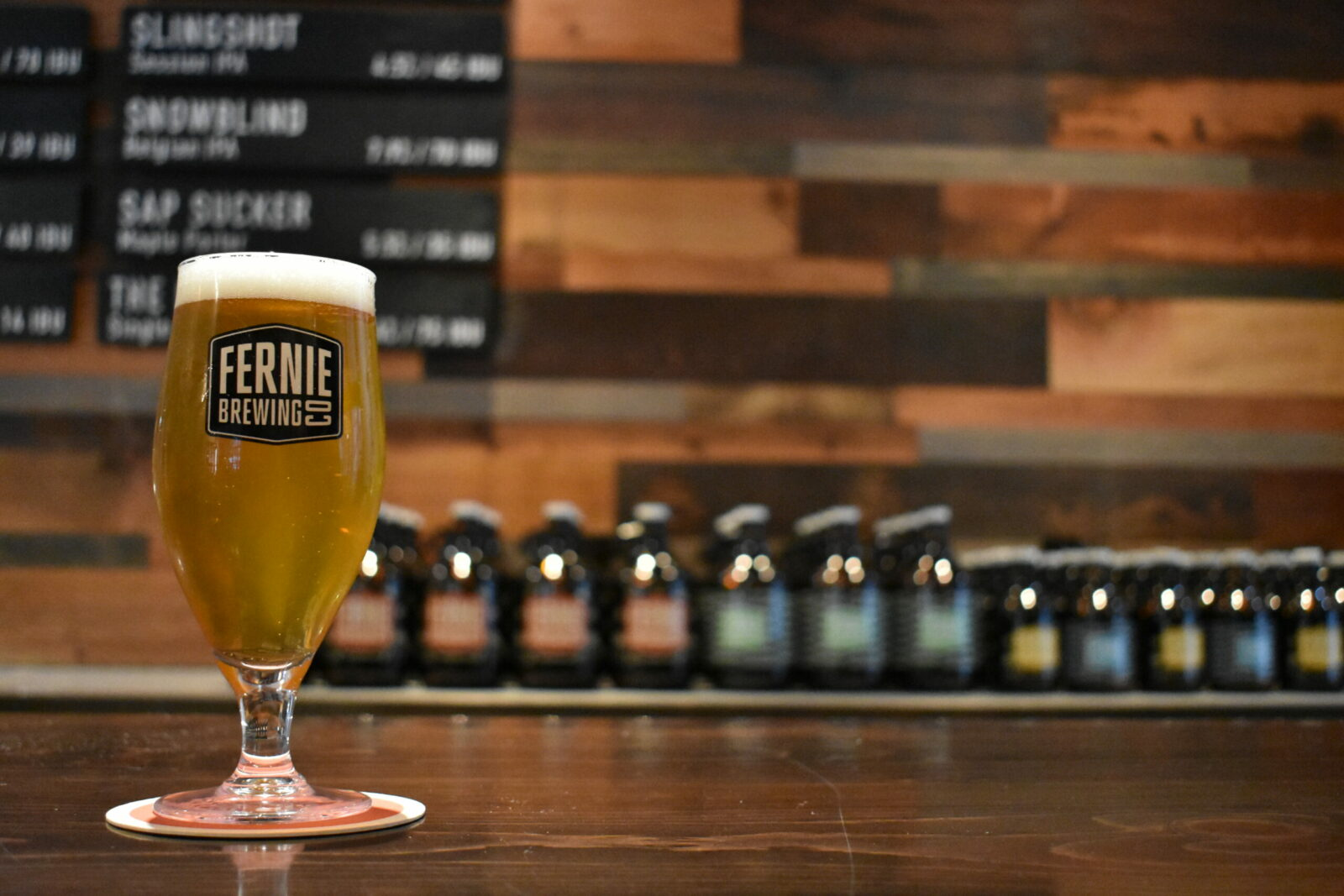 A 12oz glass of beer in the Fernie Brewing Co. Tasting Room.