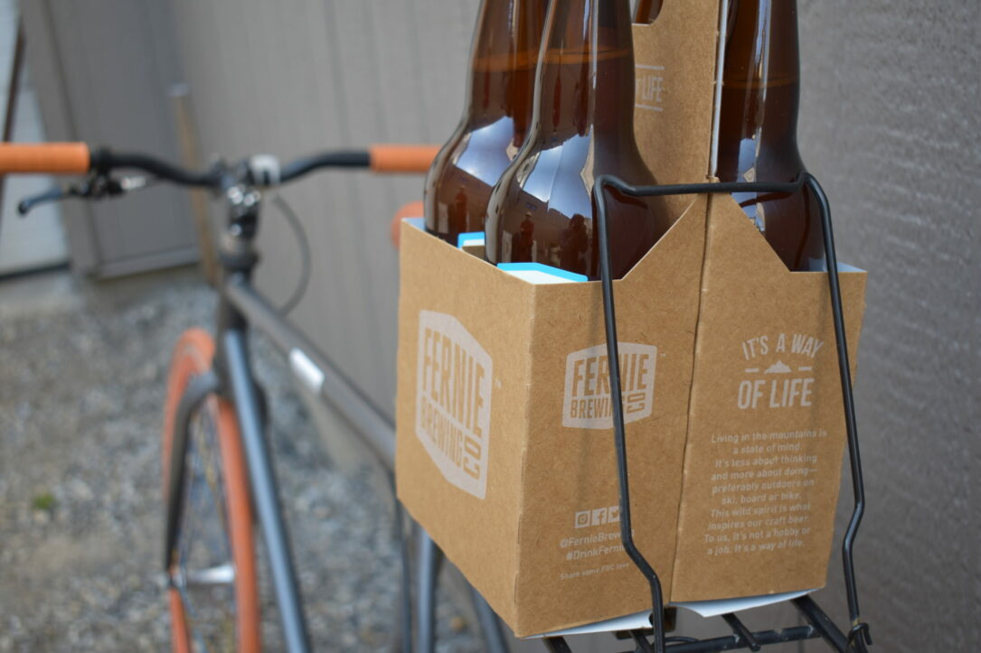 Fixie bike with beer in cardboard container on parcel shelf