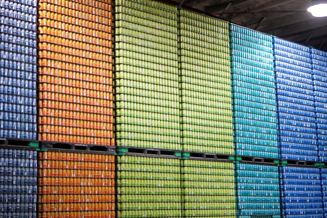 Stacks of empy beer cans in a warehouse