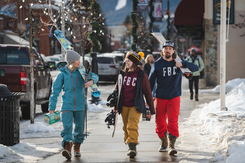 Skiers and snowboarders walking in downtown Fernie BC.