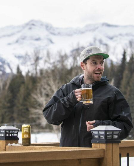Man drinking beer at Fernie Alpine Resort in winter