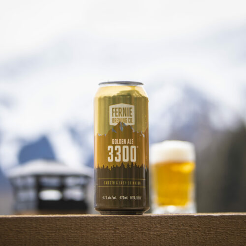 3300 Golden Ale can on a railing