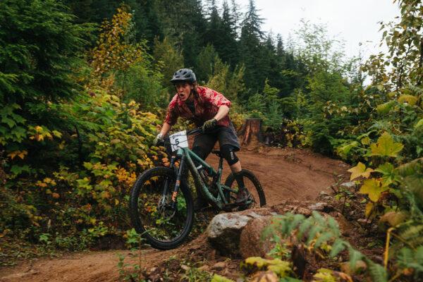 Micah Morris mountain biking in red shirt.