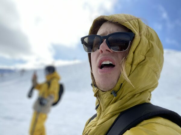 Freeskier Dyaln Siggers in yellow jacket and sunglasses.