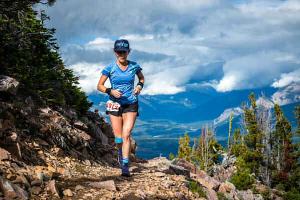 Abi Moore trail running up mountain.