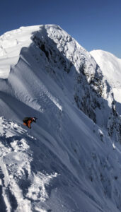 Andrea Byrne dropping in to the Fernie headwall.