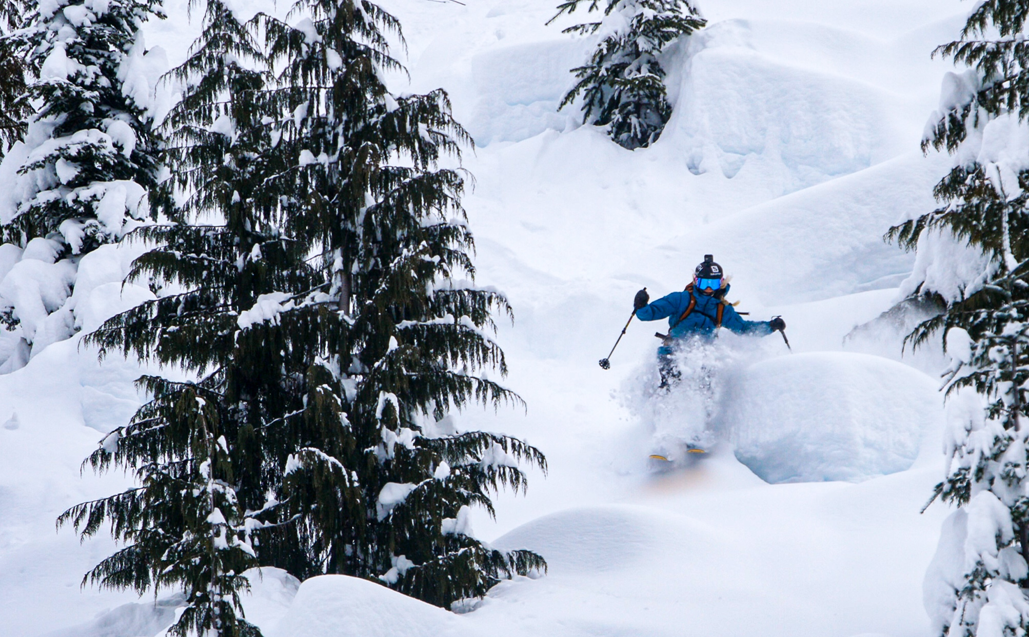 Freeskier Andre Byrne riding a pillow line.