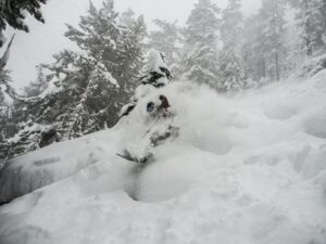 snowboarder in deep snow