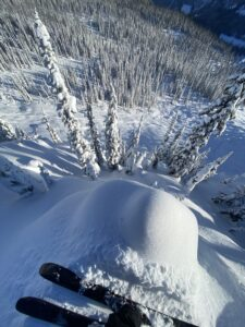 skis above big snowy run