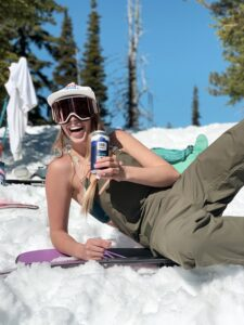 Girl laying down on snow