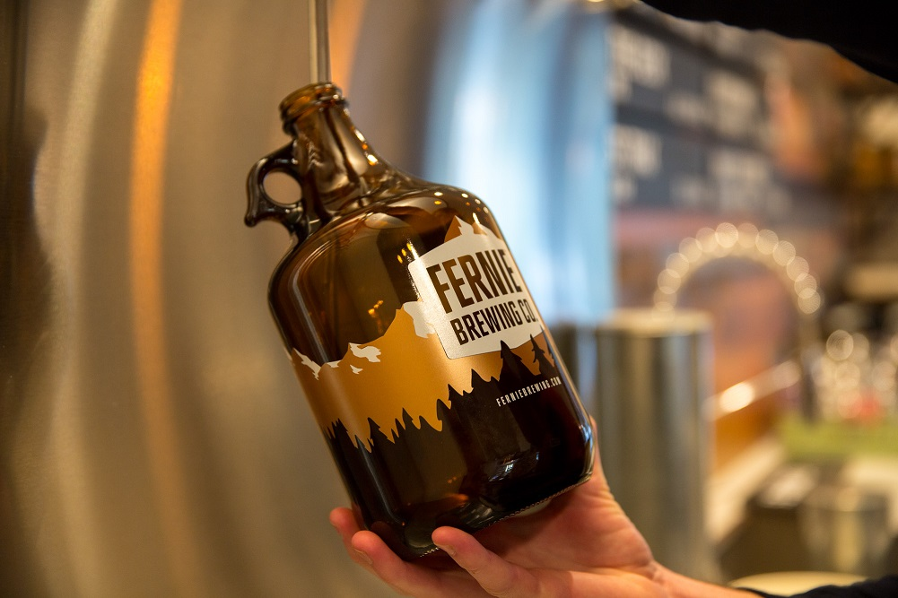 A growler being filled in the Tasting Room.