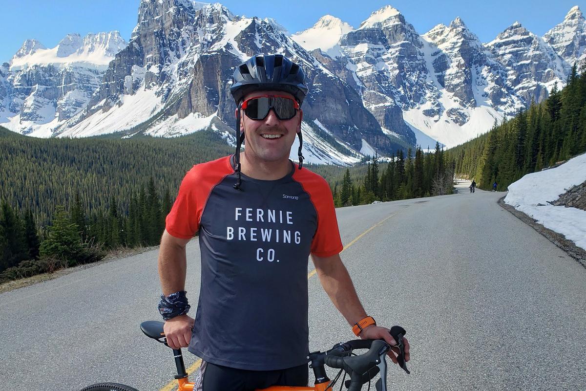 Ian ridinghis bike through the mountains.