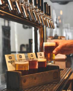 Bartender pouring flights for