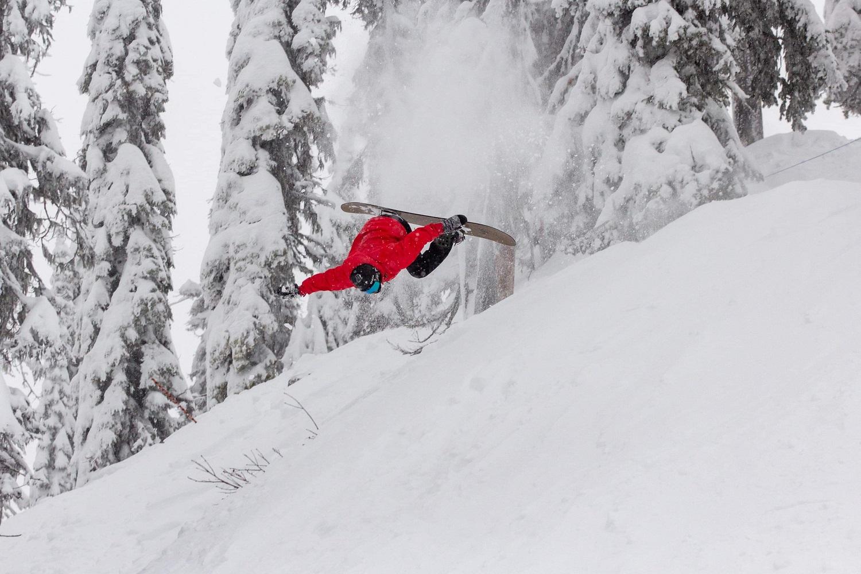 Dale hucking a backflip on a snowboard